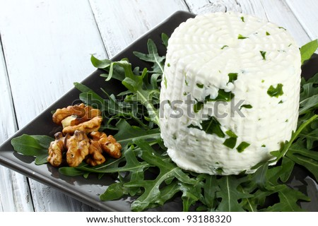 italian goat cheese with arugula and nuts - stock photo