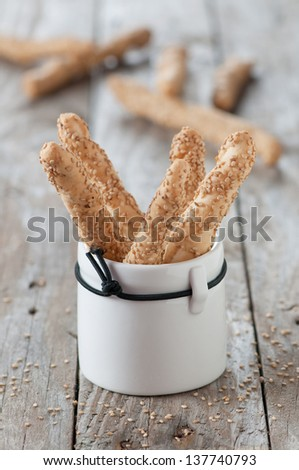 Italian grissini with sesame, selective focus - stock photo