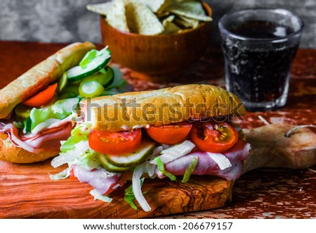 Italian hoagie with ham and vegetables - stock photo