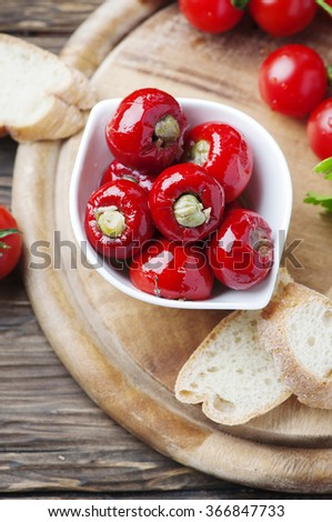 Italian hot stuffed pepper with capers and tuna, selective focus - stock photo
