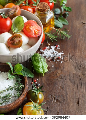 Italian ingredients for caprese salad on wooden background - stock photo