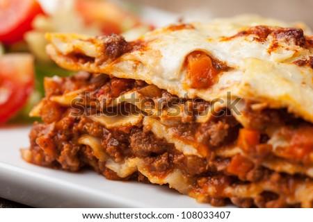 italian lasagna on a square plate - stock photo