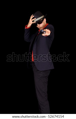 Italian looking gangster aiming a gun - stock photo