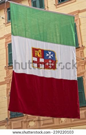 italian marine republic flag on houses background - stock photo