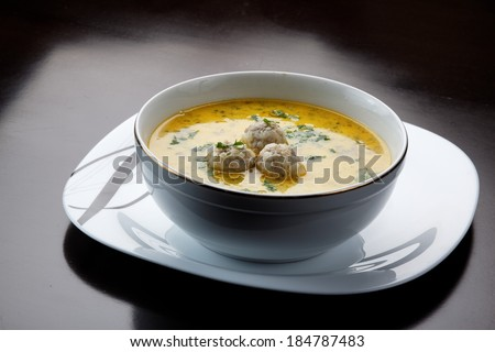 Italian meatball soup and Stellina. - stock photo