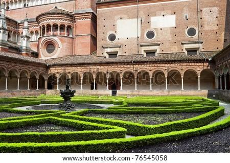 Italian Monastery Certosa di Pavia inner garden - stock photo