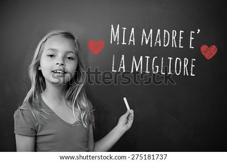 Italian mothers day message against schoolchild with blackboard - stock photo