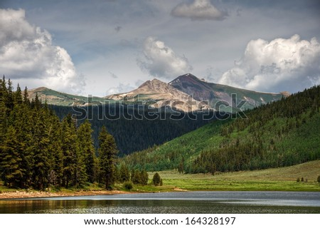 Italian Mountain stands tall above the Spring Creek Reservoir, Colorado; - stock photo