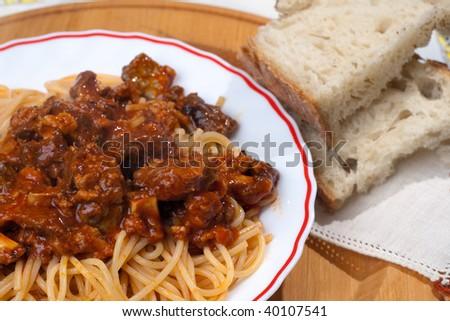 Italian Neapolitan spaghetti with Soffritto sauce and slices of bread - stock photo