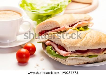 Italian panini sandwich with ham, cheese and tomato - stock photo