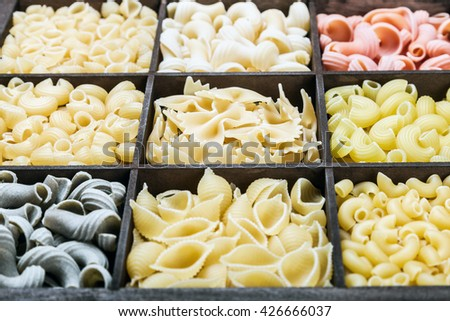 Italian pasta assortment of different colors background - stock photo