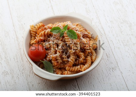Italian Pasta bolognese with parmesan cheese and basil - stock photo