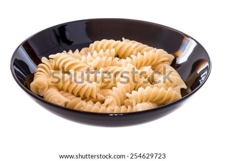 italian pasta called fusilli on dish ready for lunch - stock photo