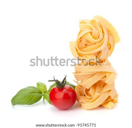 Italian pasta fettuccine nest  and cherry tomato isolated on white background - stock photo