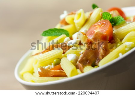 Italian Pasta Salad With Mozzarella, Bacon And Tomatoes - stock photo