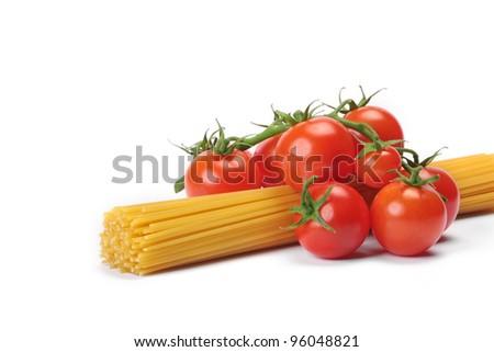 Italian pasta spagetti and cherry tomato isolated on white background - stock photo