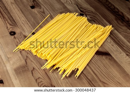 Italian Pasta spaghetti macaroni on Wooden Table. Background. - stock photo