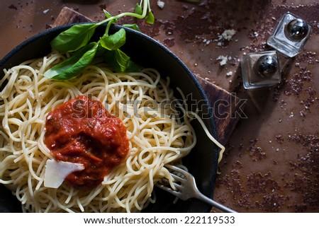 Italian pasta (spaghetti) with tomato and cheese - stock photo