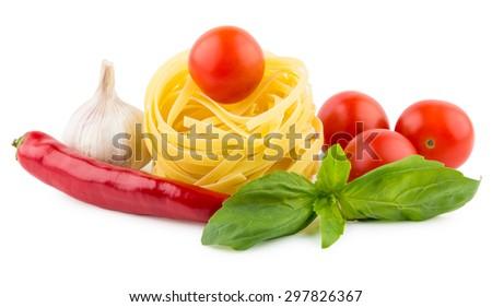 Italian pasta tagliatelle, tomatoes, garlic, chili pepper and basil leaves - stock photo