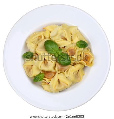Italian Pasta Tortellini noodles meal with basil isolated on plate - stock photo