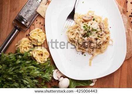 Italian pasta with mushrooms - stock photo