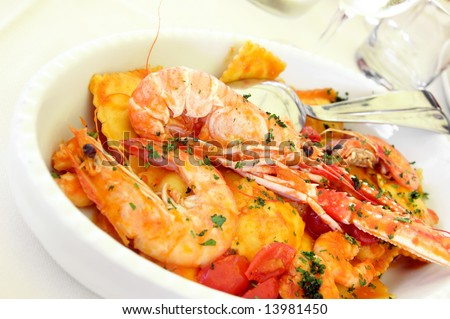 Italian pasta with seafood on a plate - stock photo