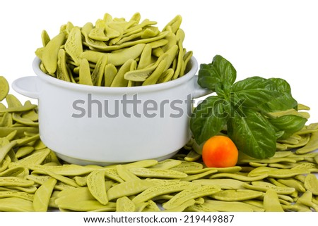 Italian pasta with spinach, basil and pepper in a porcelain dish - stock photo