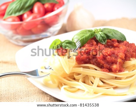 Italian pasta with tomato sauce - stock photo