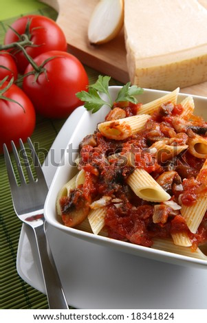 Italian pasta with tomato sauce and parmesan and fork. - stock photo