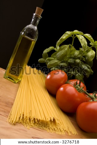 italian pasta with tomatoes basil and oil close up - stock photo