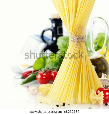 Italian Pasta with tomatoes, mushrooms, olive oil and basil - stock photo