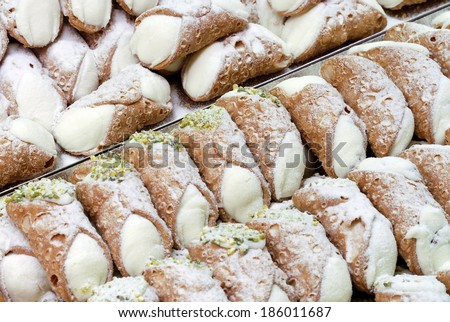 italian pastries, cannoli, typical sweet food of Sicily, Italy  - stock photo