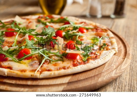 "Italian pizza ""Caprese"" lies on beautiful wooden table.  - stock photo"