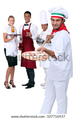 Italian pizza chef and restaurant staff - stock photo