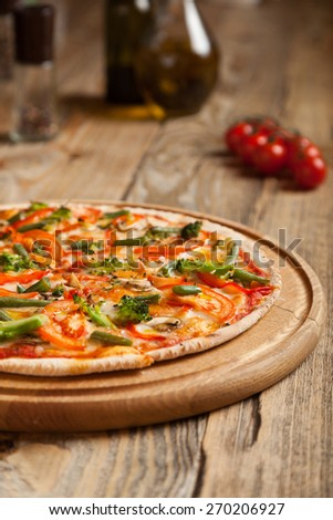 "Italian pizza ""Vegetarian"" on wooden table.  - stock photo"