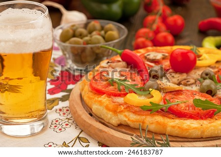 Italian pizza with glass of beer - stock photo