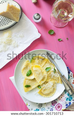 Italian Ravioli with Basil and Parmesan Cheese and Glass of White Wine - stock photo