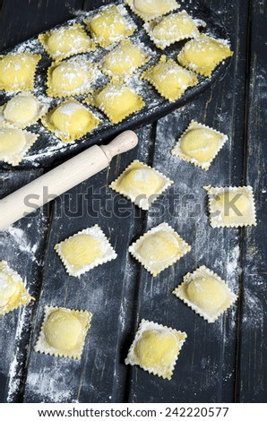 ... ravioli with ricotta cheese and fresh black truffles - stock photo