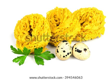 Italian raw curly fettuccine pasta with two quail eggs and parsley isolated on white background. - stock photo