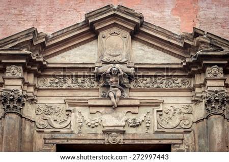 Italian renaissance door frame. Embelished entrance. Flourish motif. - stock photo