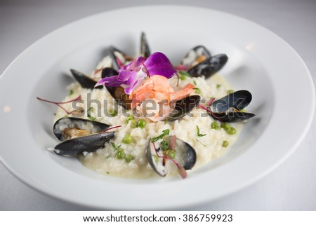 Italian risotto, mussels, shrimp, baby fava beans and parmesan cheese - stock photo