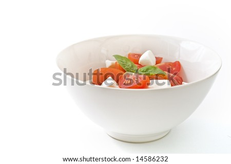 Italian salad made with cherry tomatoes, Mozzarela cheese, and fresh basil. Isolated on white - stock photo