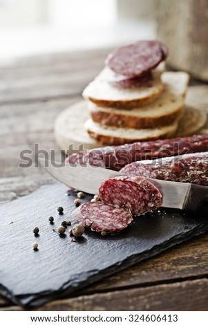 Italian salami/ salami on wooden background - stock photo