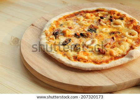 Italian Seafood tomato sauce thin Pizza served on wood plat - stock photo