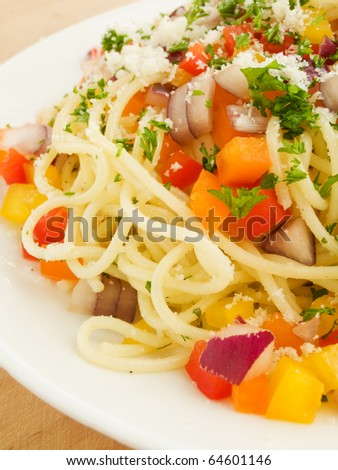 Italian spaghetti with colored peppers and onion. Shallow dof. - stock photo