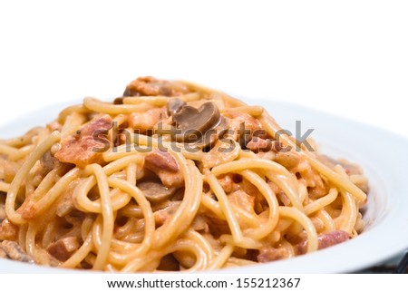 Italian spaghetti with mushrooms and bacon - stock photo