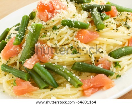 Italian spaghetti with smoked salmon and green beans. Shallow dof. - stock photo
