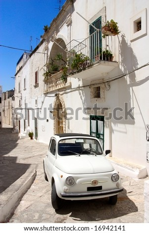 Italian street with old car - stock photo