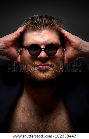Italian style rock star looking to you - stock photo