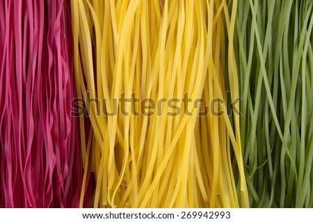 Italian tagliatelle pasta texture background - stock photo